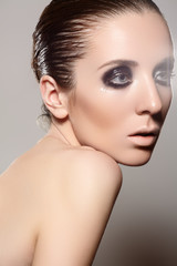 Model with dark evening smoky eyes make-up