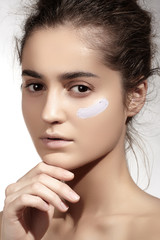 Beautiful woman model face with skin foundation base