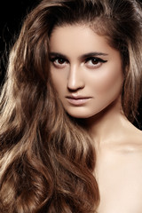 Woman model with shiny volume long hair