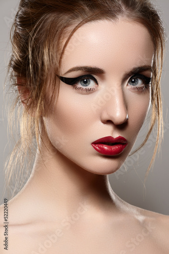 Sexy young woman model with glamour red lips