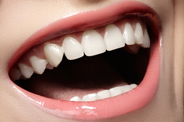 Macro happy woman's smile with healthy white teeth