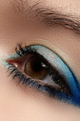 Beautiful female eye with marine colors eyeshadow