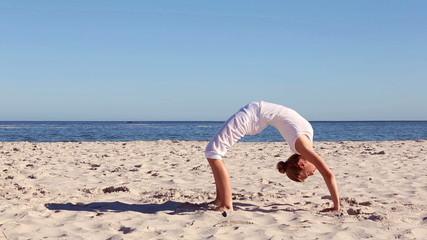 Woman doing crab yoga pose