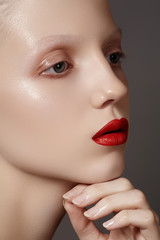 Model with sexy bright red lips make-up, clean shiny skin