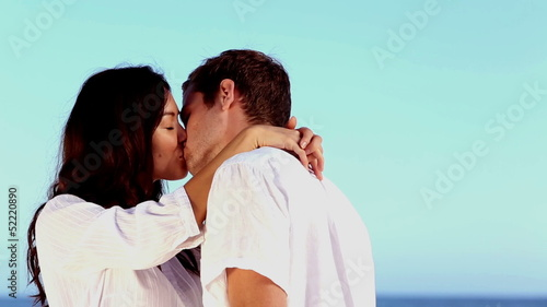 Romantic couple kissing on holiday