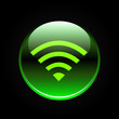 Green wifi or wireless button on black