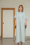 Female patient walking with crutches