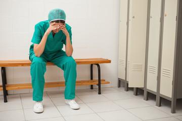 Sad nurse sitting on a bench