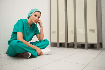 Nurse sitting cross-legged on the floor
