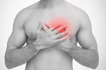 Man touching chest pain