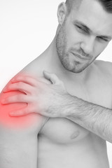 Man touching painful shoulder