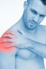 Man touching painful highlighted shoulder