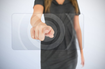 Businesswoman pressing on touchscreen panel