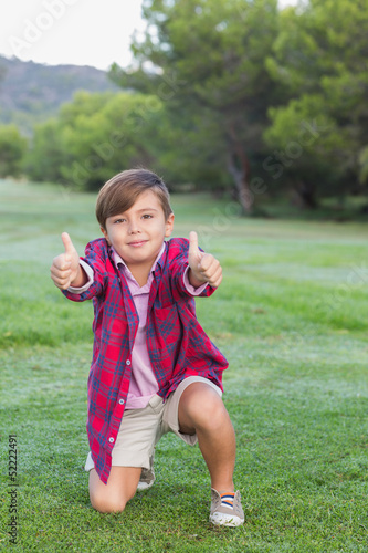 Portrait of boy giving thumbs uo