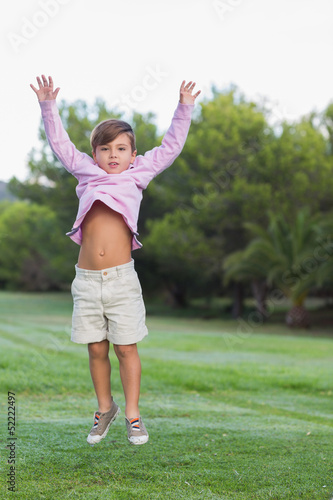 Cut boy jumping in the park
