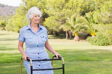Happy elderly woman with zimmer frame
