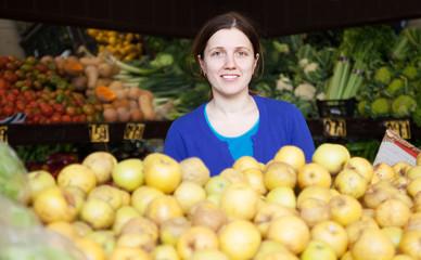 Adult woman at vegetables  market