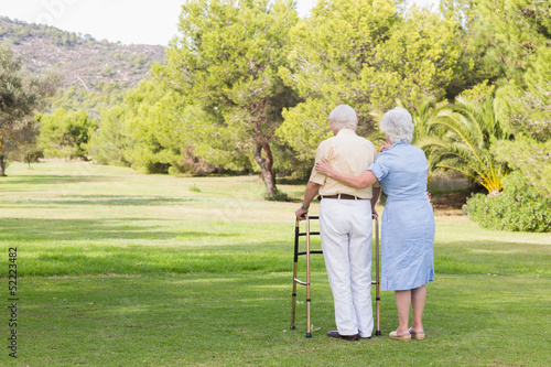 Elderly couple standing in the park