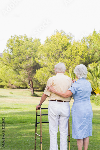 Elderly couple standing in park