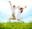 Quadro Happy Couple Outdoor. Jumping Family on Green Field
