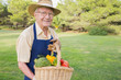 Elderly man carrying basket of vegetables