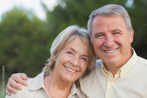 Loving older couple smiling