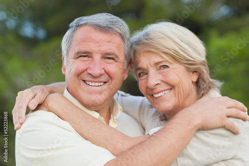 Portrait of older couple hugging