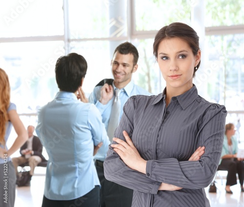 Young businesswoman in office lobby