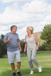 Mature woman and man jogging together