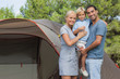 Couple with blonde son on camping holiday