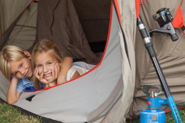 Portrait of siblings in a tent