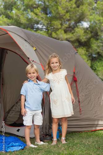 Portrait of smiling siblings at the camp site