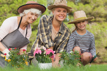 Three generations of women gardening portrait