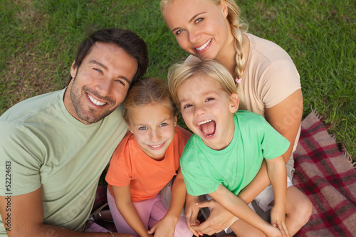 High angle portrait of young smiling family
