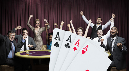Attractive group cheering at the casino with digital hand of cards