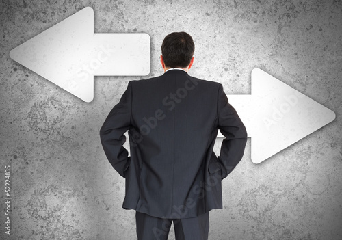 Businessman choosing which direction to go