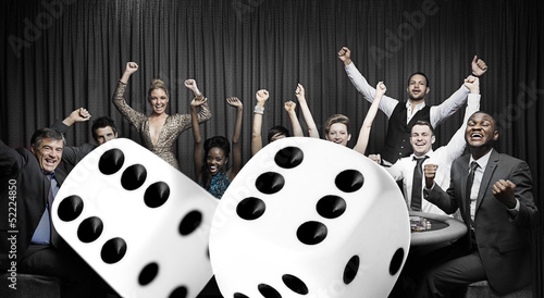 Attractive group cheering at the casino with digital dice