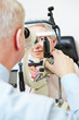 Ophthalmologist using slit lamp