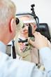 Ophthalmologist using slit lamp