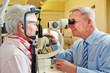 Ophthalmologist examing senior woman