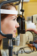 Woman at eye examination with slit lamp