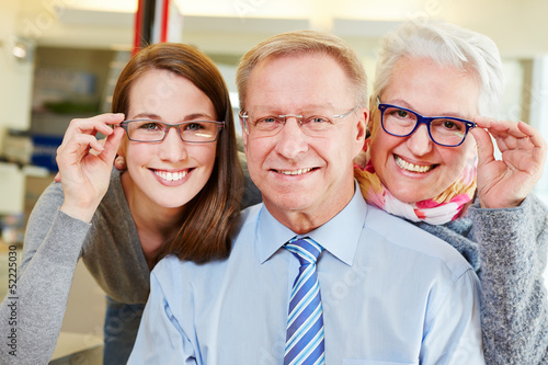 Family buying new glasses at optician