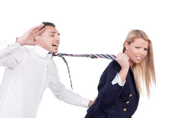 Woman pulling a man by his tie