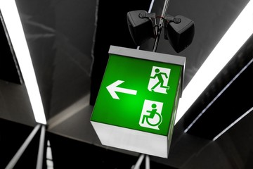 Green exit sign with abstract background