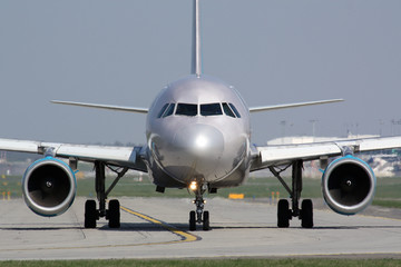 Taxiing silver plane