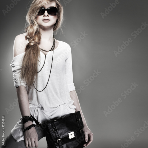 beautiful girl is in fashion style on  grey  background
