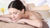 happy woman relaxing in spa salon
