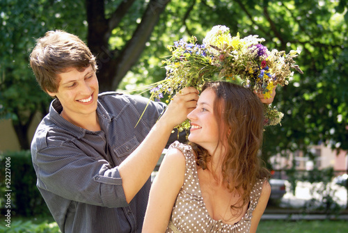 Happy young couple with diadem