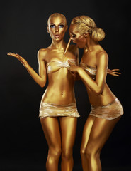 Gilt. Coloring. Two Funny Women with Paintbrush. Golden Makeup