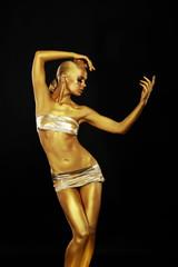 Radiance. Golden Statue. Gilded Woman's Body. Gold Bodyart